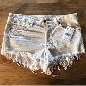 Free People Worn White Distressed Shorts